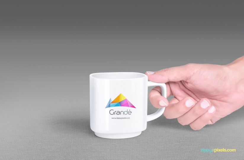 FREE MUG MOCKUP WITH 7 UNIQUE HOLDING POSITIONS by ZippyPixels