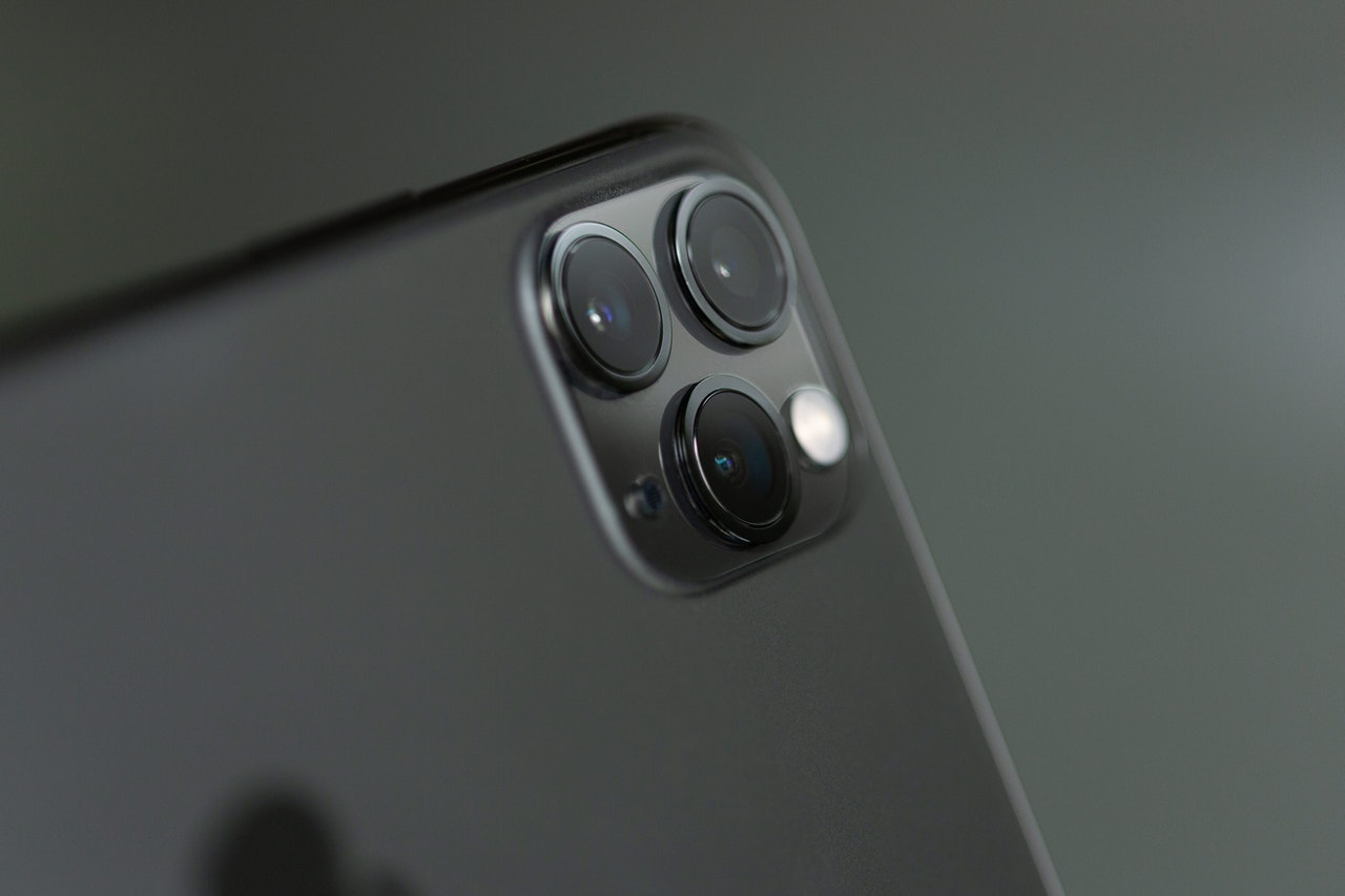 How do phone skins help to protect the camera lens?